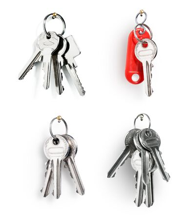 keys isolated: Key ring with house door keys collection isolated on white background Stock Photo