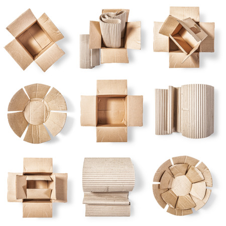 business roles: Open cardboard box, corrugated role and paper plate. Packaging material collection. Objects group  isolated on white background. Top view, flat lay Stock Photo