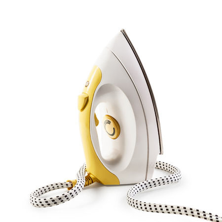 smoothing: Yellow steam smoothing iron isolated on white background