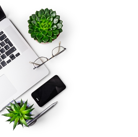 Office table desk. Workspace with laptop, succulent, eye glasses, smart phone and pen isolated on white background clipping path included. Design element. Flat lay, top view