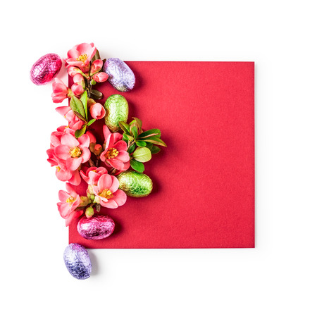 Easter greeting card with japanese quince flowers, chocolate eggs and note paper. Holiday composition isolated on white background clipping path included. Spring arrangement and design element, flat lay, top view