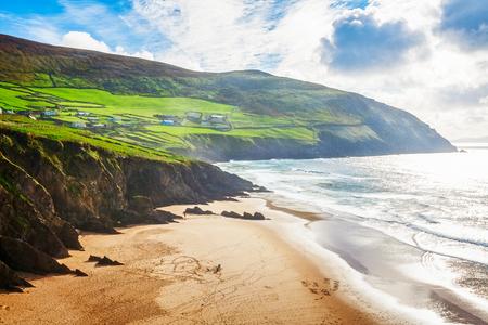 Landscape of sandy beach, hills and atlantic ocean. Ring of Kerry, Ireland. Travel destination