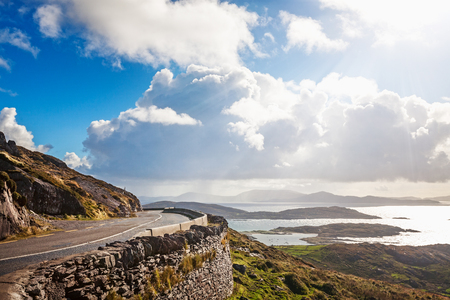 Landscape of mountain road, hills and atlantic ocean. Ring of Kerry, Ireland. Travel destination 写真素材