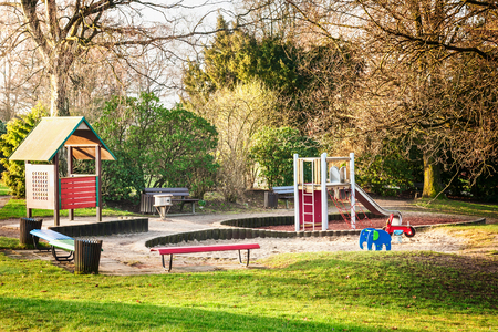 Playground in public city park. Early spring landscape and urban childhood concept