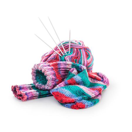 Knit socks, knitting needle and wool ball isolated on white background clipping path included. Needlework at home concept