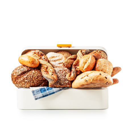 Vintage bread box with various bread, rolls and buns isolated on white background clipping path included