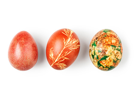 Easter eggs handmade floral painted isolated on white background. Holiday symbol and tradition. Object group with clipping path, top view, flat lay