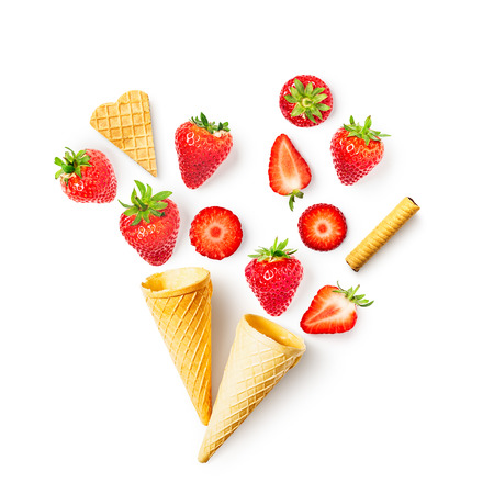 Fresh strawberry in waffle cone composition isolated on white background. Healthy eating and dieting concept. Spring fruits arrangement. Top view, flat lay, design elements collection
