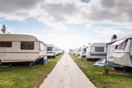 Caravan camping on the beach. Family vacation in caravan park. North sea coast, Germany