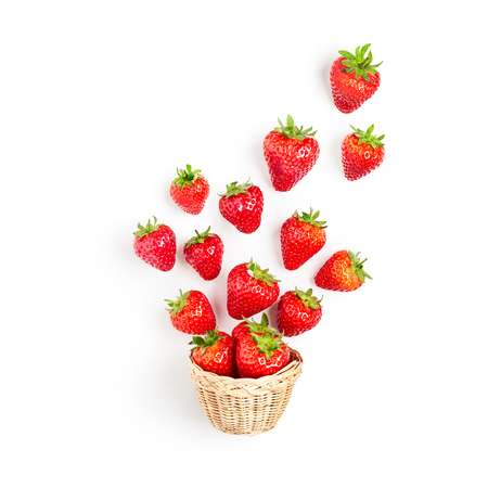 Fresh strawberries in basket composition isolated on white background. Healthy eating and dieting concept. Spring fruits arrangement. Top view, flat lay, design element