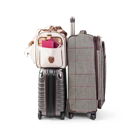 Suitcase and travel bag with passport isolated on white background clipping path included. Summer time, vacation and travel concept