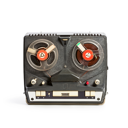 Vintage portable tape recorder with audio reels. Single object isolated on white background with clipping path. Retro technology