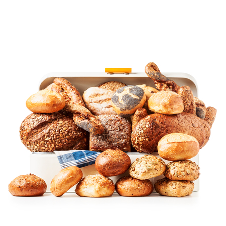 Vintage bread box with various bread, rolls and buns isolated on white background clipping path included  写真素材
