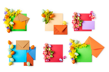 Easter greeting card with flowers, eggs, note paper and envelopes collection. Holiday composition isolated on white background. Spring arrangement and design element, top view, flat lay 写真素材