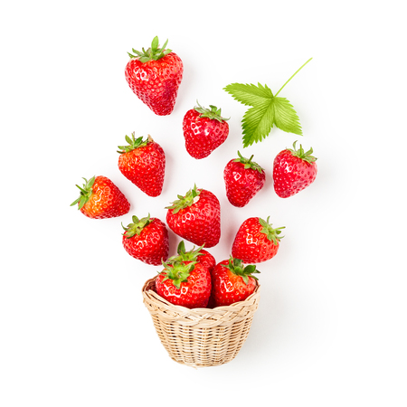 Fresh strawberries in basket isolated on white background. Healthy eating and dieting concept. Spring fruits arrangement. Object group with clipping path, top view, flat lay, design element 写真素材
