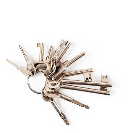 Keys on key ring arrangement isolated on white background clipping path included. Design element, top view, flat lay. Security concept
