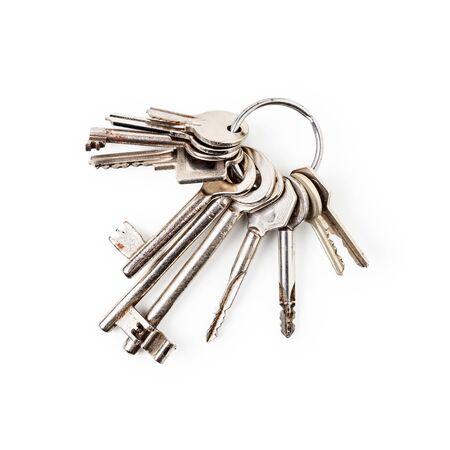 Keys on key ring arrangement isolated on white background