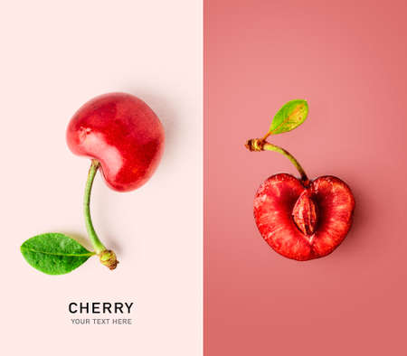 Fresh cherry fruits with leaf as creative layout. Healthy eating and food concept. Red berries composition. Flat lay, top view. Design elements, color card with copy space