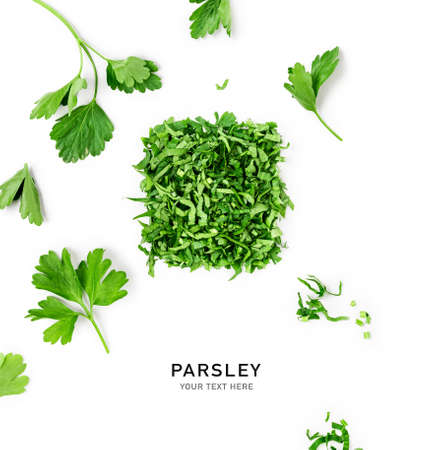 Creative layout with fresh parsley leaves. Bunch and chopped parsley composition on white background. Top view, flat lay. Floral design elements. Healthy eating and dieting concept Stock Photo