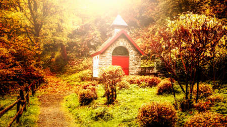 Little church in fall colors. Autumn forest landscape in Germany