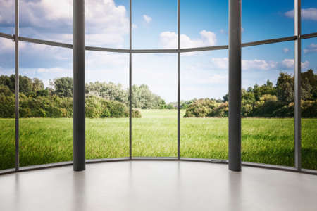Glass window of empty round shape room with landscape view. Windows frame with clipping path