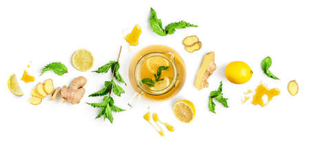 Ginger tea with lemon, mint and honey banner. Creative composition and layout isolated on white background. Healthy eating and food concept. Top view, flat lay, design elements Stock Photo