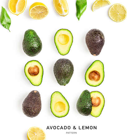 Avocado and lemon creative composition isolated on white background. Food, healthy eating and dieting concept. Tropical fruits pattern and layout. Flat lay, top view Stock Photo