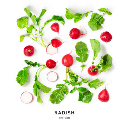 Fresh radish with leaves creative pattern on white background. Healthy eating and dieting food concept. Whole and sliced fresh radishes composition and design elements. Top view, flat lay