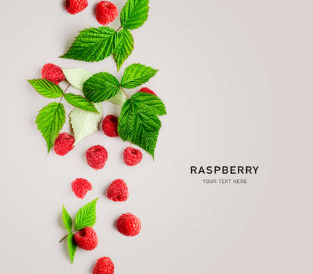 Raspberries with leaves creative layout on gray background. Healthy food and dieting concept. Summer raspberry fruit composition and border. Top view, flat lay, design card Stock Photo