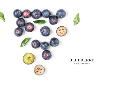 Fresh blueberry fruits and leaves creative layout isolated on white background. Healthy food concept. Summer bilberry composition. Top view, flat lay, design elements