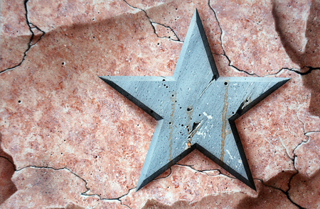 abstract wall background. Metal star on a stone background. Aerography Reklamní fotografie - 75014806