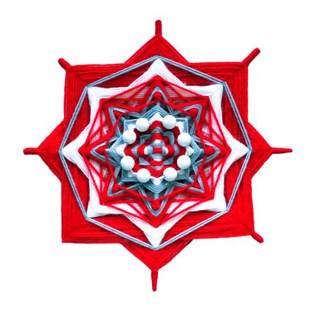 Wicker mandala on white background. Red and white gamma Reklamní fotografie - 75014825