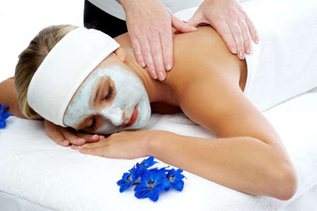 Woman having a massage treatment at a beauty spa  Stock Photo