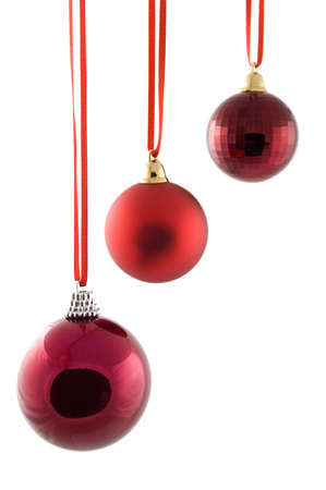 Red Christmas Baubles isolated on a white background photo
