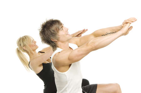 Muscular man and pretty blonde woman doing cardio exercises isolated on a white background photo