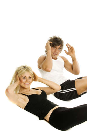 Pretty blonde woman and muscular man doing cardio exercises isolated on a white background photo