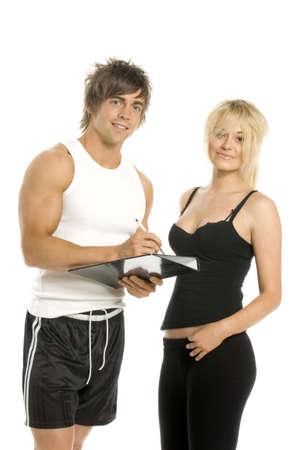 Athletischer Mann und Frau in der Turnhalle zu tragen in einer Form auf einem wei�en Hintergrund f�llen Lizenzfreie Bilder