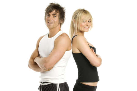 Athletic man and woman in gym wear smiling isolated on a white background Standard-Bild