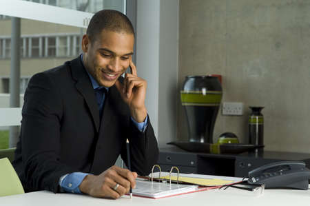 Man working to a desk in office building photo