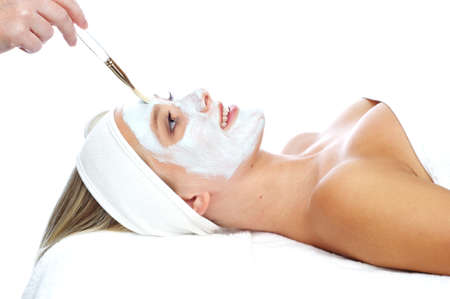 Young, beautiul, blonde woman having treatments at a day spa isolated on a white background photo