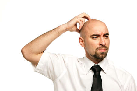 Businessman isolated on a white background scratching his head photo