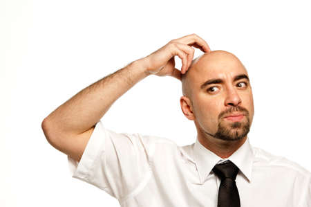 Businessman isolated on a white background scratching his head Stock Photo