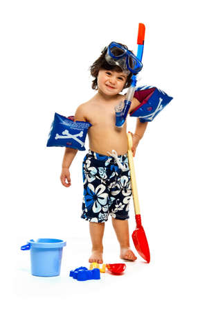 Young boy isolated on a white background playing in swimwear, ready for the beach Standard-Bild