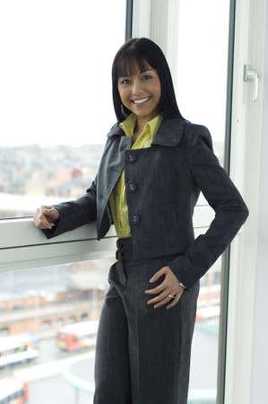 Stylish business woman smiling at the camera photo