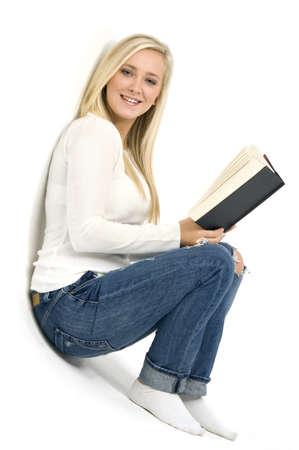 Young blonde woman with a book isolated on a white background