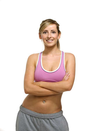 athletic wear: Beautiful, blonde Athletic woman in gym wear isolated on a white background Stock Photo