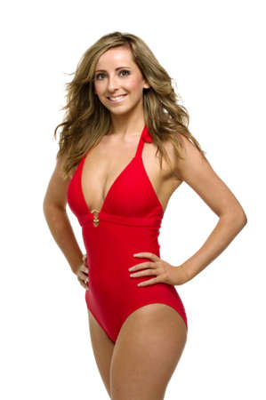 dark blond: Beautiful woman stood with her hands on her hips wearing a red swimsuit