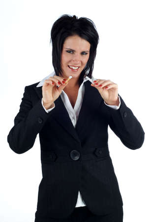 snapped: Business woman smiling holding up a snapped cigarette isolated on a white background