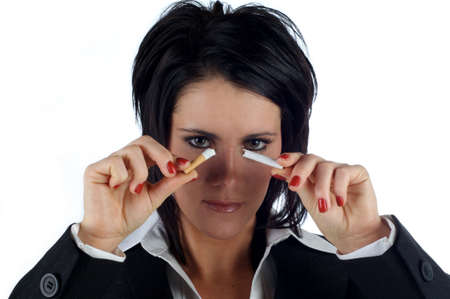 Business woman holding a snapped cigarette infront of her face isolated on a white background