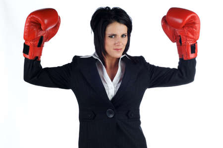 Business woman in a suit looking happy while wearing red boxing gloves. Isolated on a white background Stock Photo